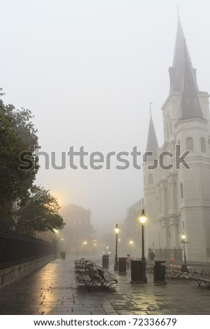 Early morning fog on Jackson square obscures St. Louis Cathedral in New Orleans, Louisiana