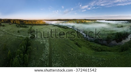 Early morning. Fog over the river. Aerial view