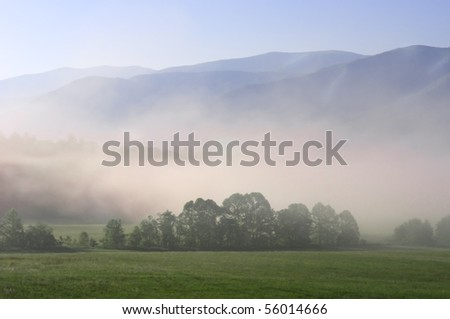 Early morning fog settling into the valley of Cades Cove in Great Smoky Mountain National Park, Tennessee, USA