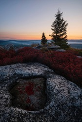 Early morning glow cresting over the horizon on an early October morning from the Dolly Sods Wilderness on the Appalachian Front in West Virginia.