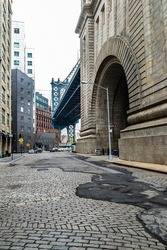Early morning in commercial area of DUMBO neighborhood, or Down Under Manhattan Bridge Overpass, on the Brooklyn side of New York City, USA, across the East River from Manhattan
