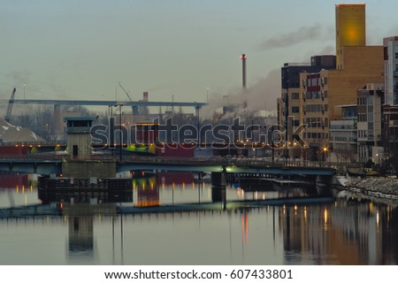 Early morning light above the downtown Walnut Street and Main Street bridges, with Tower Drive rising up above the mouth of Fox River and Green Bay in Green Bay, Wisc.  #607433801