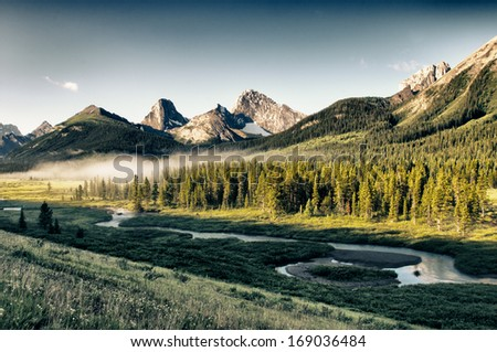 Early morning mist in scenic rocky mountains