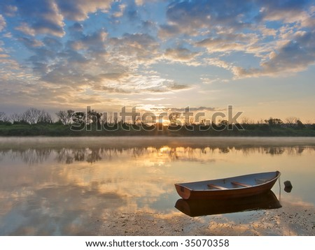 Early morning on a river. Landscape with boat