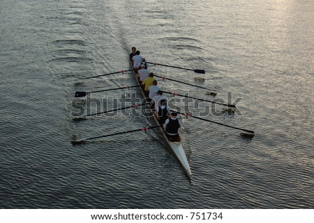 Early morning rowers training on the river.