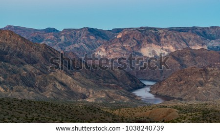 Early morning scenic overlook of the Colordao River in the valley of rugged mountains.