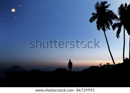 Early morning sky with moon and stars and a person looking at the landscape below