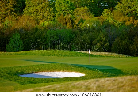 Early morning spring scene of a beautiful idyllic golf course in vibrant colors.