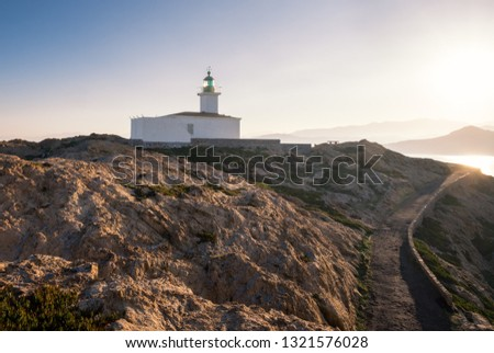 Early morning sun on the lighthouse at La Pietra rock in Ile Rousse in the Balagne region of Corsica