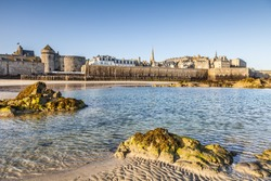 Early morning sun on the old French port of St Malo, Brittany, France.