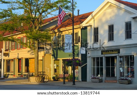 Early morning sunlight on businesses of a quaint village main street