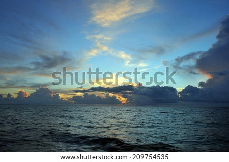 Early morning sunrise over Miami Beach skyline with tropical clouds at horizon #209754535