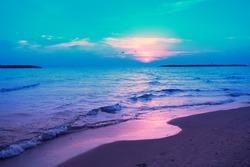 Early morning, sunrise over sea. Blue pink beautiful sunrise. Twilight time on the beach. Wild nature.