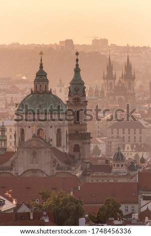 Early morning view of Prague, Czech Republic. St. Nicholas Church and Church of Our Lady before Tyn visible.