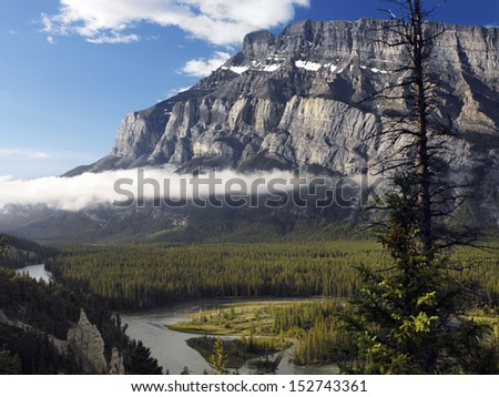 Early morning view of the Rocky Mountains in Banff National Park in Alberta, Canada.  The Hoodo Rock Formation is in bottom left of view.