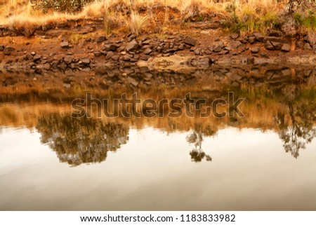 Early morning view of waterway with sunrise clouds reflecting in the water