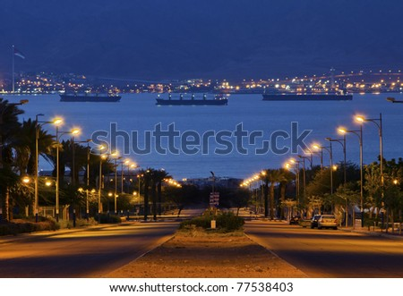 Early morning view on the Red Sea and port Aqaba from the longest street of Eilat city, Israel