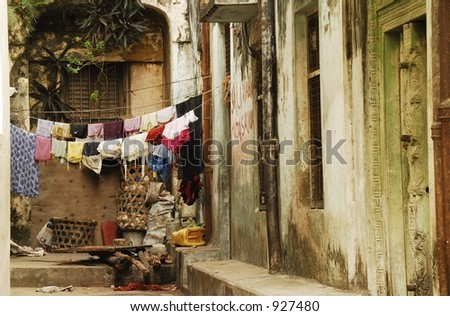 Early-morning washing hung between houses lining Stonetown alleys, Zanzibar Island