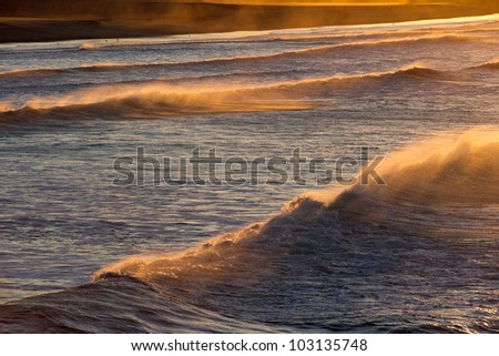 Early morning waves breaking near the beach in Southern California