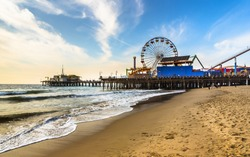 early morning winter Santa Monica pier beach sunny day