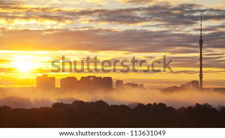 early morning yellow sunrise in autumn city