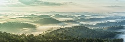 Early on a sunny plateau sunny with warm colors,  below clouds covered hills cradling durable as on planes Elysium. The vast pine forests between clouds crept created many impressive sight