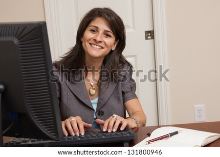 Early 40s business woman working in her home office