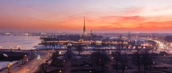 Early spring sunset panorama of Peter and Paul fortress in Saint-Petersburg, Russia, fog, street lights