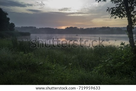 Early summer misty morning over the lake
