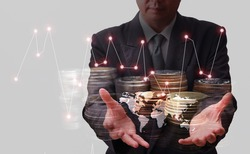 Earn money concept with businessman that holds golden coins