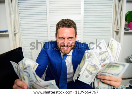 Earn money easy business tips. Man cheerful happy businessman with pile dollar banknotes. Profit and richness concept. Che k out my profit this month. Businessman formal suit hold cash dollars hands. Stock foto ©