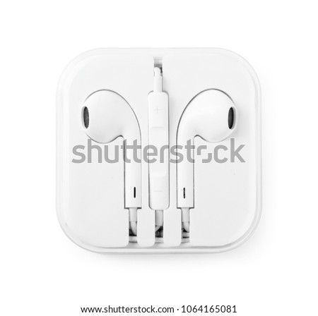 Earphones in plastic storage case isolated on white background