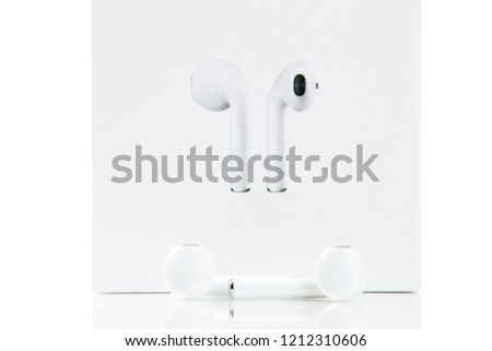 Earphones. Unpackage earphones with original box isolated on white background. Wireless sound electronics. New technologies.