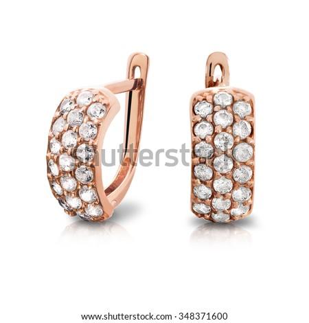 Earrings. Gold earrings with diamonds. Jewelry