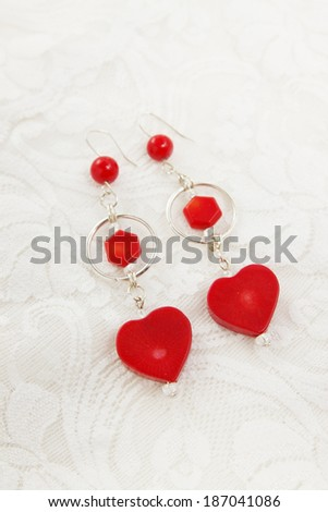 Earrings in silver and red coral in the shape of heart #187041086