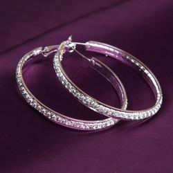 earrings on purple background