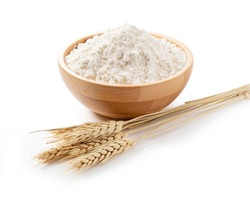 Ears of wheat and flour in a wooden bowl on a white background. Close-up, Material Photo
