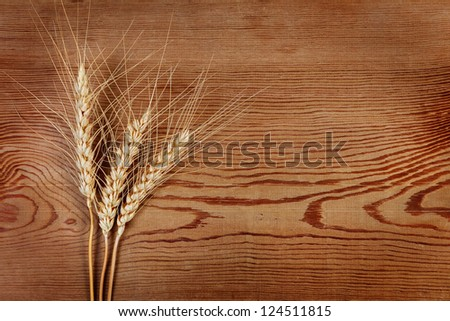 Ears of wheat on a wooden background