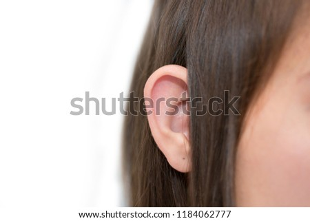 Ears protruding from under the hair, otolaryngologist treatment of diseases in the ears, hearing loss, eavesdropping, Otoplasty plastic surgery, elf ears, lop-eared big-eared #1184062777