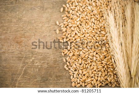 ears spike and wheat on wood texture background