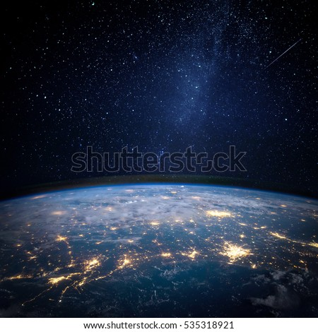 Stock Photo Earth and galaxy. Elements of this image furnished by NASA.