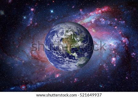 Earth and galaxy on background. Elements of this image furnished by NASA. #521649937
