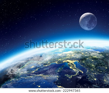 Earth and moon view from space at night -  Europe, elements of this image furnished by NASA