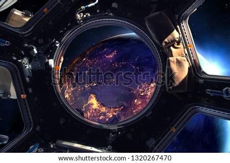 Earth and Spacecraft. Elements of this image furnished by NASA