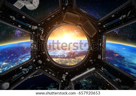 Earth and Spacecraft. Elements of this image furnished by NASA. - Shutterstock ID 657920653