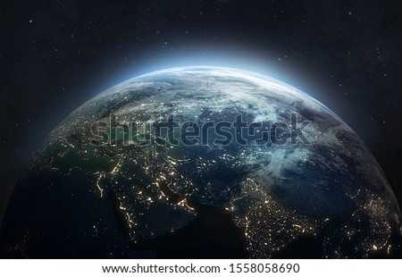 Photo of  Earth at he night. Abstract wallpaper. City lights on planet. Civilization. Elements of this image furnished by NASA