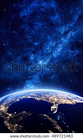 Earth at night as seen from space with blue, glowing atmosphere and space at the top. Perfect for illustrations. Elements of this image furnished by NASA. 3d illustration #489721483
