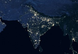 Earth at night, view of city lights showing human activity in India from space. Part of South Asia on world dark map on global satellite photo. Elements of this image furnished by NASA.