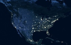 Earth at night, view of city lights showing human activity in USA from space. North America on world dark map on global satellite photo. Elements of this image furnished by NASA.