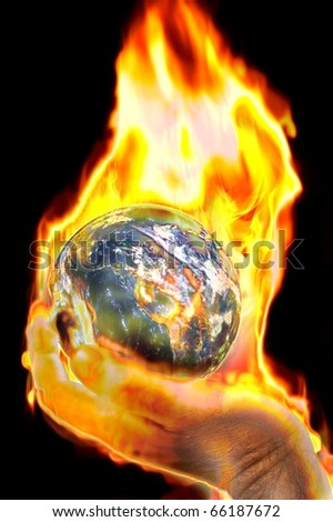 earth burning in mans hand concept image